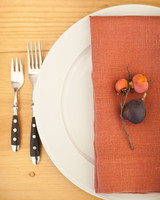 Simple Table Setting with Orange Linens and Figs