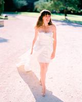 bride wearing short wedding dress with detachable train