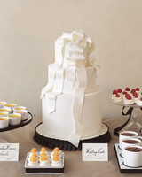 Three-Tiered White Wedding Cake with Edible Bow and Ribbon