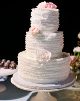 Three-Tiered White Wedding Cake with Ruffled Layers
