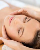 Woman receiving face massage