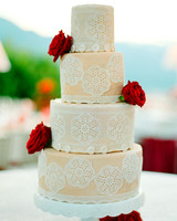 Lacy Wedding Cake with Red Flowers