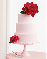 Pink Wedding Cake with Big Red Flowers