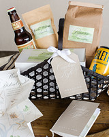Welcome baskets with popcorn, beer and destination wedding maps