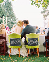 mr and mrs chalk board sign boards attached to green chairs