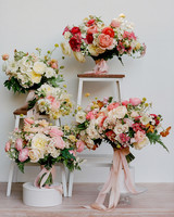 various bouquets of roses displayed on stools