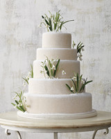 Five-Tiered White Wedding Cake with Powdered Sugar and Candy Snowdrops
