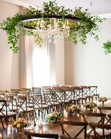 wedding chandelier sleek black circle with greenery