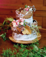 nature themed wedding cake with floral and greenery accents