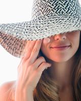Woman Wearing Sunscreen and Sun Hat