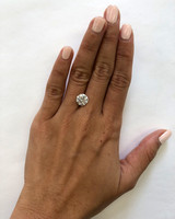 hand with 2 carat diamond