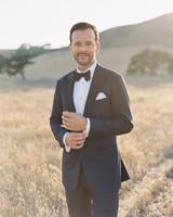 katie mike wedding groom in field