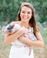 kelsey jacob wedding bride holding pig