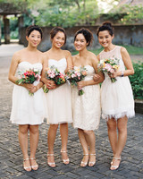 bridesmaids wearing mismatched short white dresses