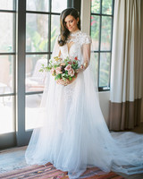 paige zack wedding bride ball gown in front of window