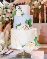 three tiered geometric design wedding cake with rose embellishments