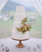 sloan scott wedding white cake with flowers