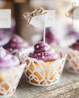 purple frosted cupcakes with white polka dot sprinkles