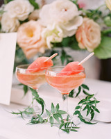 two glasses of frozen rose on table with flowers