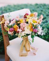 beth john wedding bouquet on chair