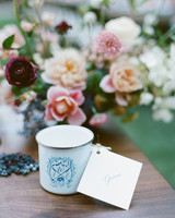 escort cards tied on camp-style mugs