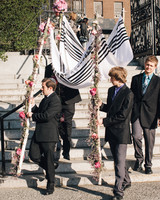 guests carrying chuppah