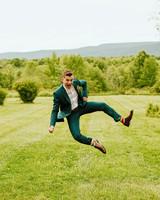 rose chris wedding groom jumping in field
