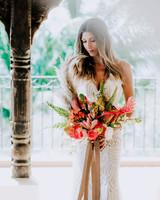 mini pineapple, fan palms, mini roses, calathea, orchids, and pampas grass wedding bouquet
