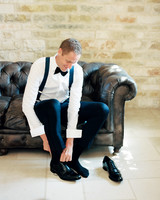groom wearing traditional tuxedo with bowtie and cufflinks