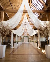 wedding chandelier crystal with sheer draping elevated ceilings