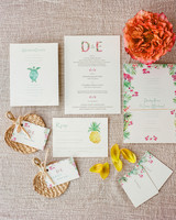 bright floral themed stationary suit with flower monograms and pineapple and turtle emblems