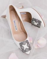 ivory Manolo Blahniks heels with buckle design