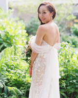 bride wearing a nude lining and lace appliques Yaniv Persy gown