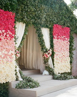 wedding plant wall pink roses and greenery