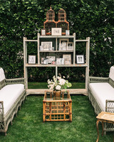mia patrick wedding lounge seating with tables and shelving with photos