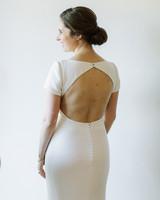 a matte cream, open-backed, elegant minimal mermaid gown