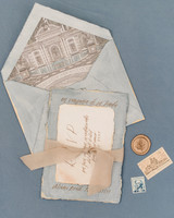 vintage pale blue and creme colored wedding invites with bronze wax seal