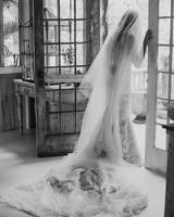 sarah daniel wedding bride looking out french door