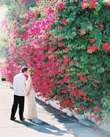 beth john couple pink flower wall kiss