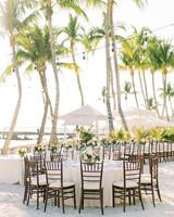 beth john wedding reception table below palm trees