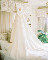 Sareh Nouri wedding dress hanging above bed
