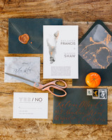 black and orange marble print accent on black stationary with orange calligraphy