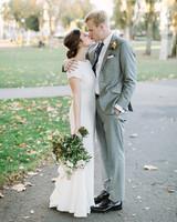 bride and groom kissing on walkway outside