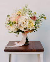 bouquet of white and pink roses with yellow scabiosa