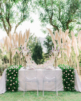 sweetheart table outdoor grass backdrop symmetrical display