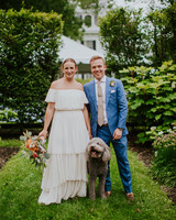 bride and groom posing with their dog
