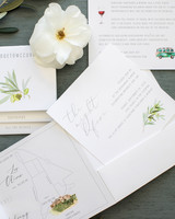 white stationary suit with olive leaves design