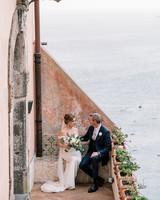 cara david wedding couple sitting on steps above coast