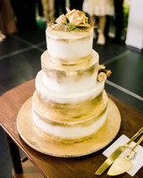 marshmallow butter cream covered four-tier wedding cake