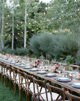 long wooden tables with blue and white placesettings